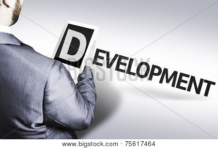 Business man with the text Development in a concept image