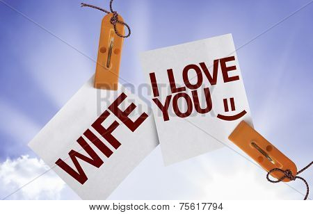 Wife I Love You on Paper Note on sky background