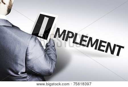 Business man with the text Implement in a concept image