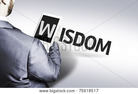 Business man with the text Wisdom in a concept image