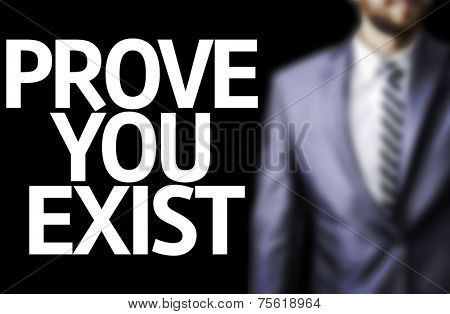 Prove you Exist written on a board with a business man on background