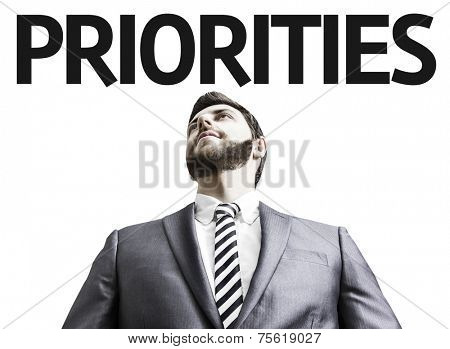 Business man with the text Priorities in a concept image