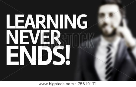Business man with the text Learning Never Ends in a concept image