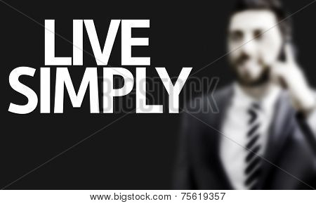 Business man with the text Live Simply in a concept image