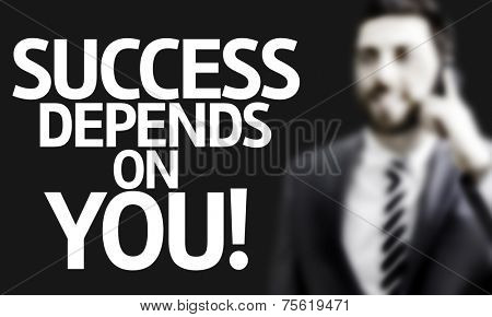Business man with the text Success Depends On You! in a concept image