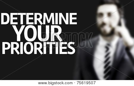 Business man with the text Determine your Priorities in a concept image
