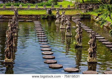 Warriors Statues On A Pond