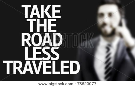 Business man with the text Take the Road Less Traveled in a concept image