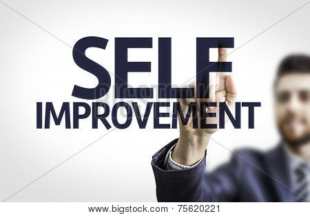Business man pointing to transparent board with text: Self Improvement