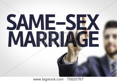Business man pointing to transparent board with text: Same-Sex Marriage