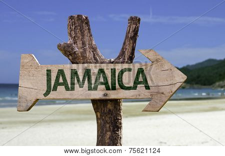 Jamaica wooden sign with a beach on background