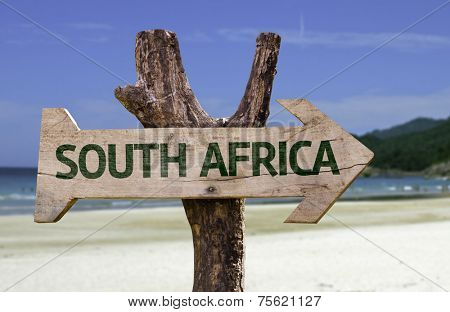 South Africa wooden sign with a beach on background