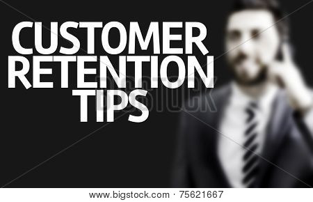 Business man with the text Customer Retention Tips in a concept image