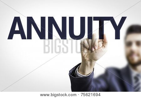 Business man pointing to transparent board with text: Annuity