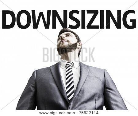 Business man with the text Downsizing in a concept image