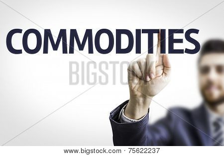 Business man pointing to transparent board with text: Commodities