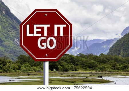 Let It Go wooden sign with a landscape background