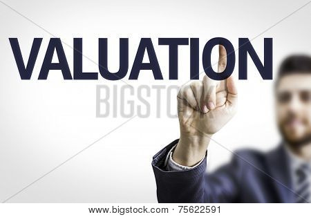 Business man pointing to transparent board with text: Valuation
