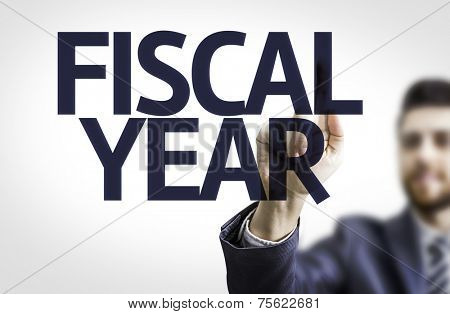 Business man pointing to transparent board with text: Fiscal Year