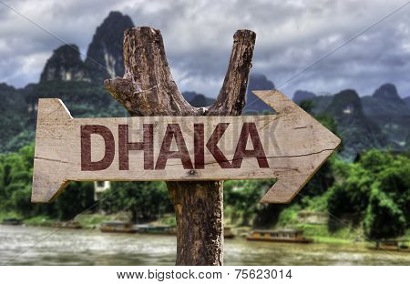 Dhaka wooden sign with agricultural background