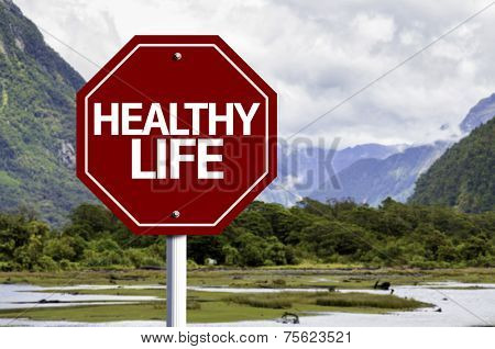 Healthy Life written on red road sign with landscape background