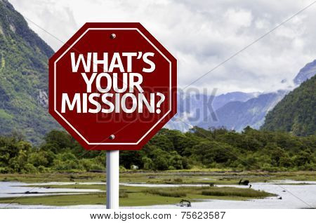 Whats Your Mission? written on red road sign with landscape background