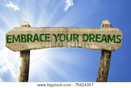 Embrace Your Dreams wooden sign on a beautiful day
