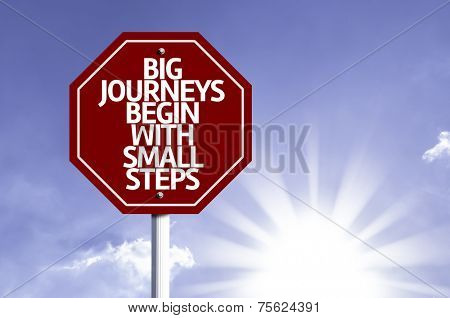 Big Journeys Begin With Small Steps written on red road sign with a sky on background