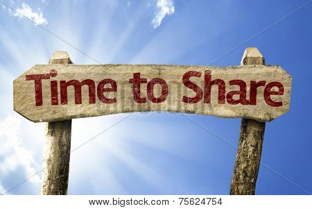 Time to Share wooden sign on a beautiful day