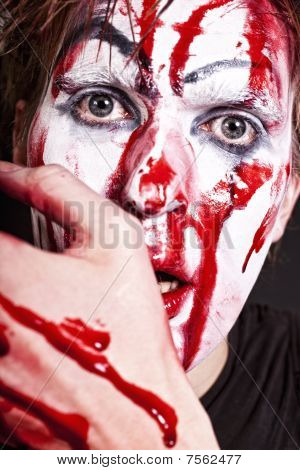 Mime With Blood On Face And Hand