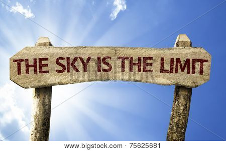 The Sky is The Limit wooden sign on a summer day