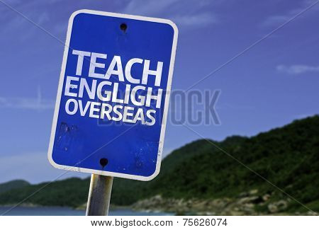 Teach English Overseas sign with a beach on background