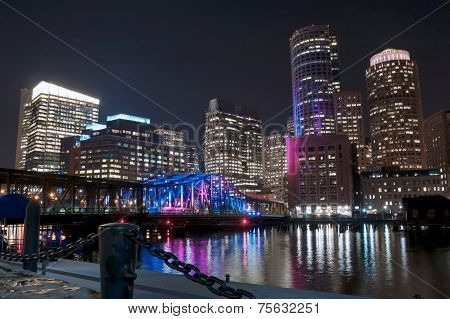 Boston Harbor And Financial District At Night In Boston, Massachusetts.