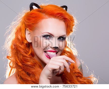 Cat woman with red hair