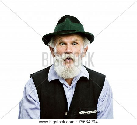 Old bavarian man in hat looking upwards isolated