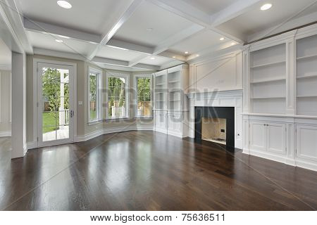 Family room in new construction home with fireplace
