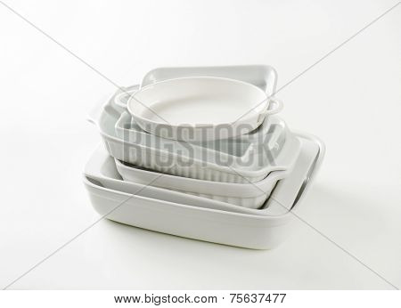 stack of empty baking trays on white background