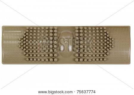 A brown foot massage plastic pad for a self reflexology treatment