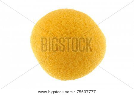 A round yellow natural facial Sponge made of vegetable fiber, Konjac, isolated on white