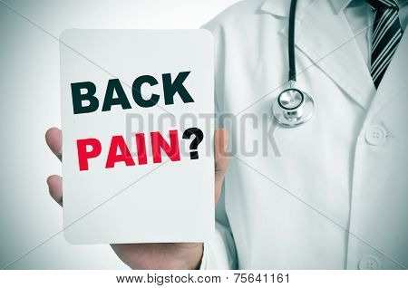 a doctor showing a signboard with the question back pain? written on it