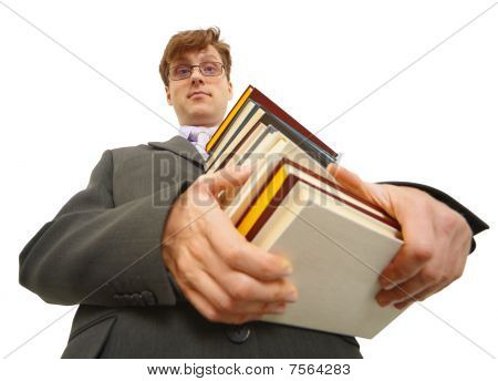 Young Man With Pile Of Books In Hands