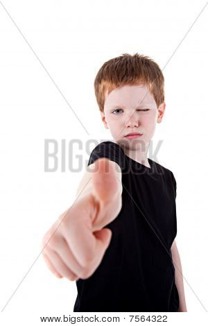 Portrait Of A Cute Young Boy, With Thumb Up