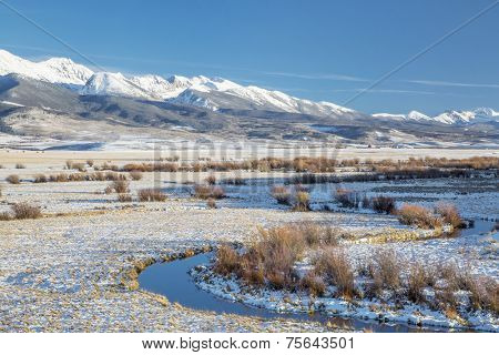 meanders of Canadian River and Medicine Bow Mountains in North Park near Walden, Colorado, late fall scenery