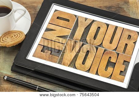 find your voice creativity concept - word abstract in letterpress wood type on a digital tablet with a cup of coffee