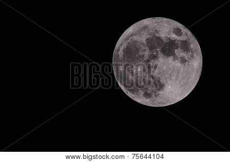 Full moon isolated on a black sky