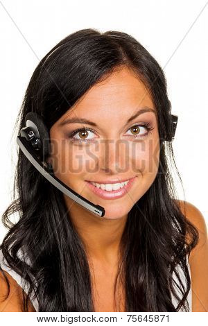 a young woman in a customer service center phone with customer with a headset