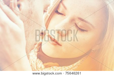Beautiful Woman Embraces A Man