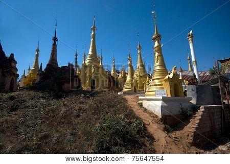 Group Of Golden Pagodas Of Shwe Inn Taing Paya Near Inle Lake , Myanmar.