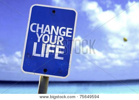 Change your Life sign with a beach on background