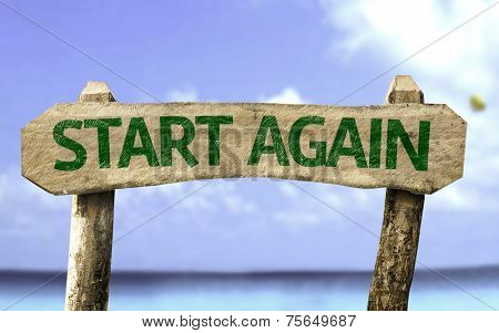 Start Again sign with a beach on background